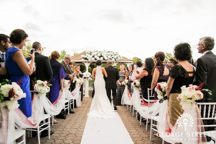 cute bride and father walking towards the wedding altar wedding photo