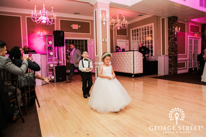 cute kids enetring the reception hall at coral house wedding photo