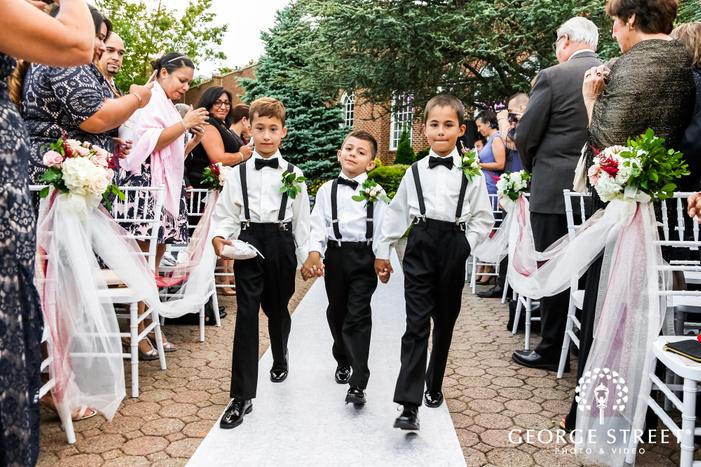 cute ring bearers walking down the aisle wedding photo