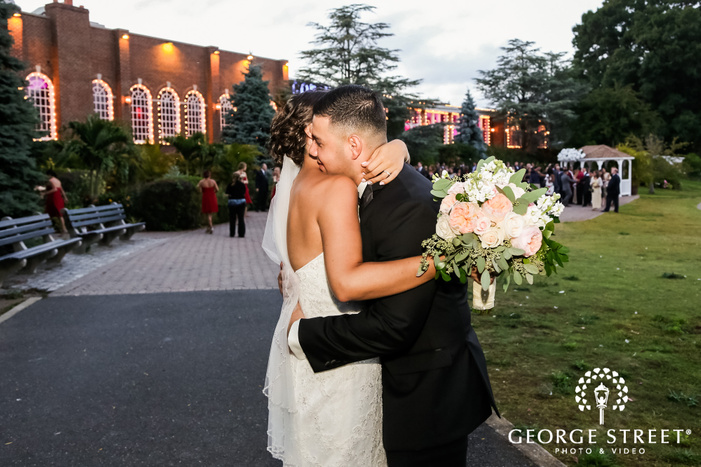 lovely couple on walkway at coral house in new york wedding photo