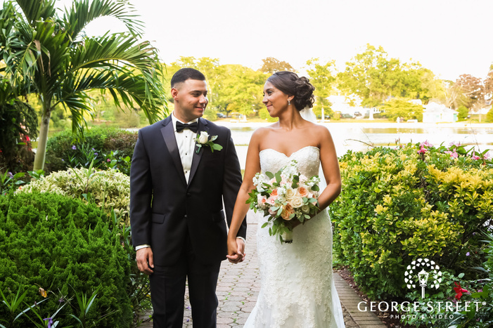 loving bride and groom on walkway at coral house wedding photos
