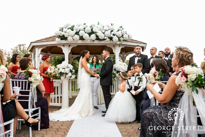 loving bride and groom vows excahnge at wedding altar in new york wedding photos