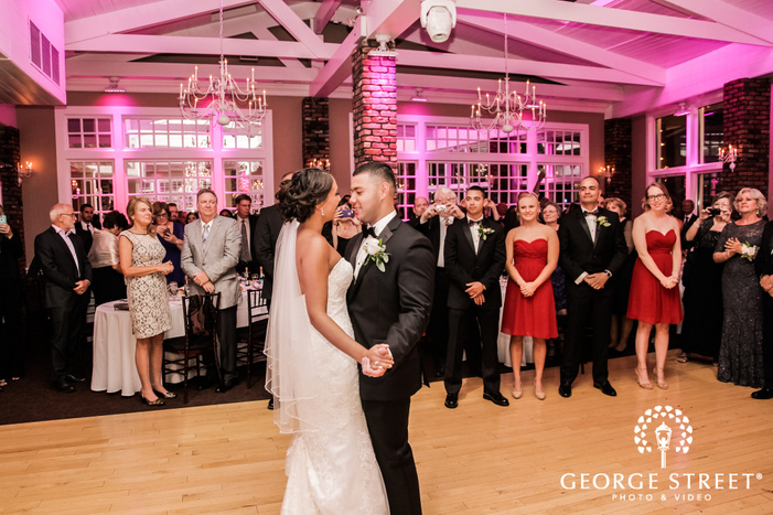 sweet bride and groom first dance in reception at coral house wedding photos