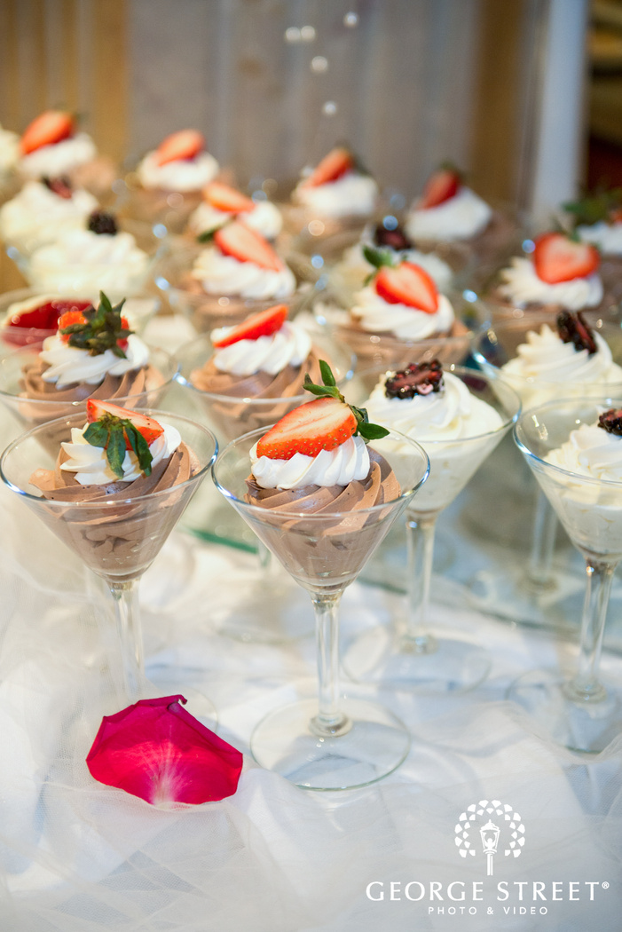desserts in cocktail glasses at reception