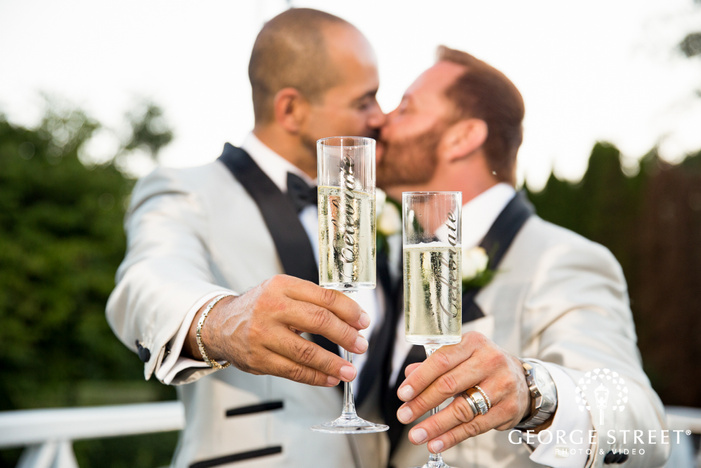 grooms holding champagne glasses
