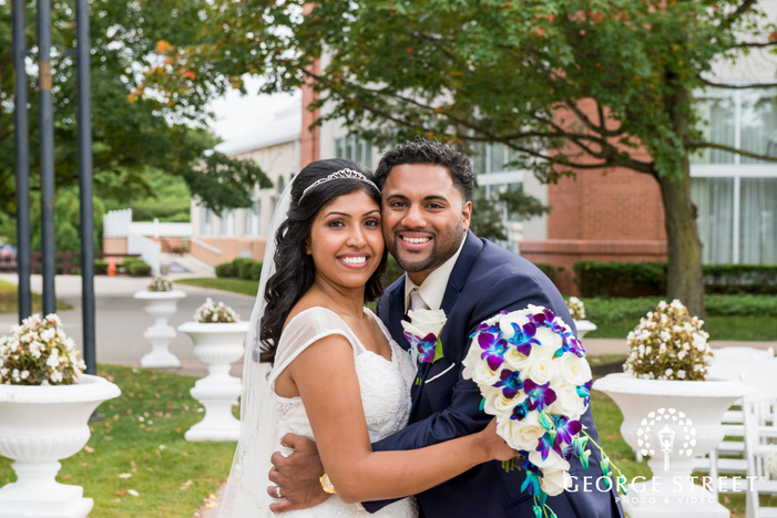 smiling bride and groom classic outdoor portrait