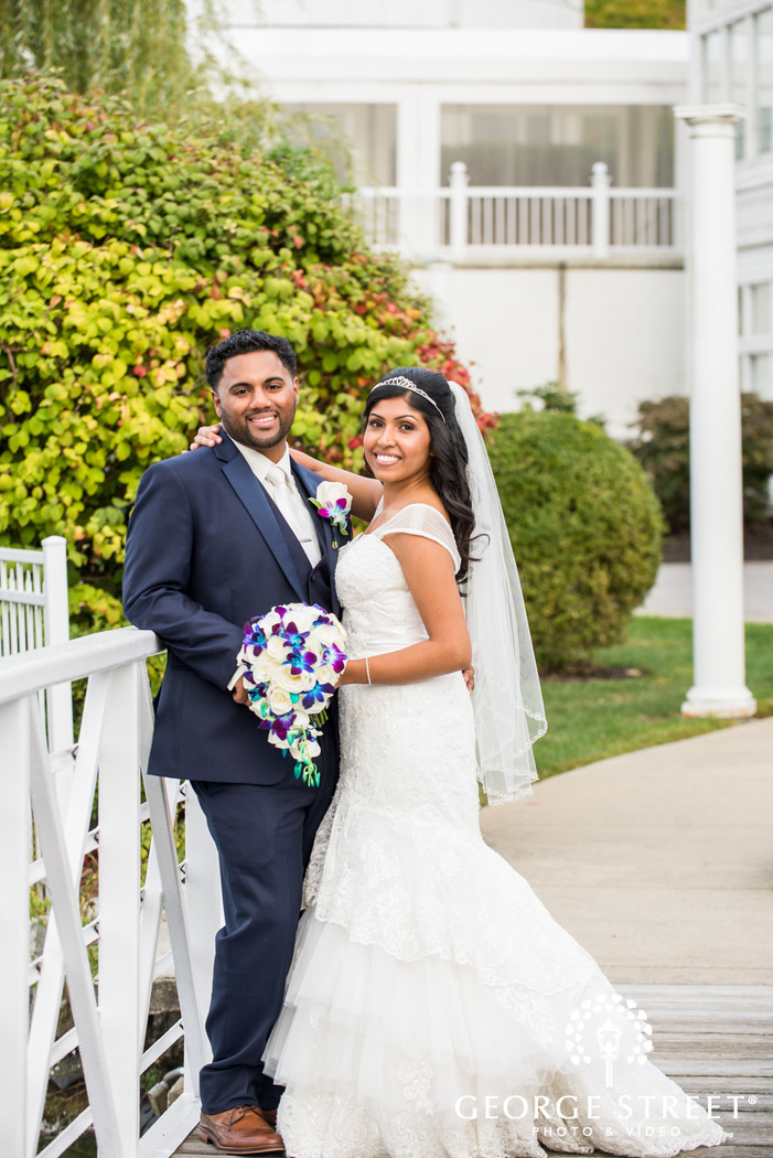 smiling bride and groom sunny outdoor portrait