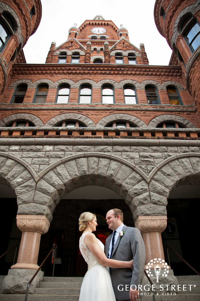 bride and groom in front of old red museum of dallas