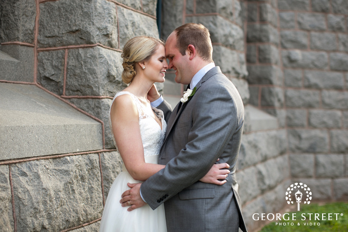 bride and groom touching heads outdoor portrait