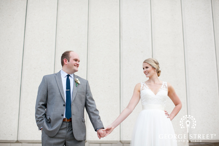 candid bride and groom holding hands gorgeous urban portrait