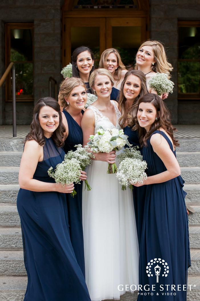 smiling bride and bridesmaids outdoor portrait