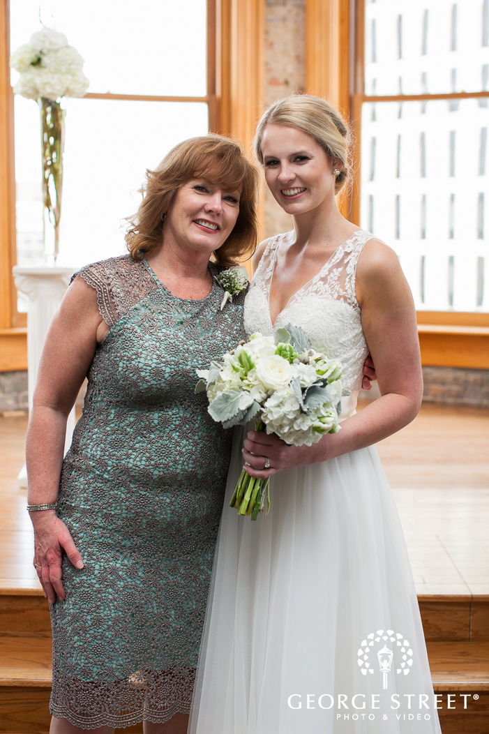 smiling bride posing with mother