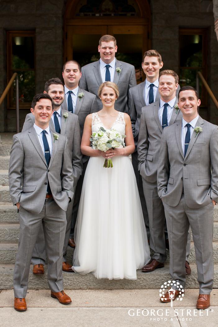 smiling bride with groomsmen