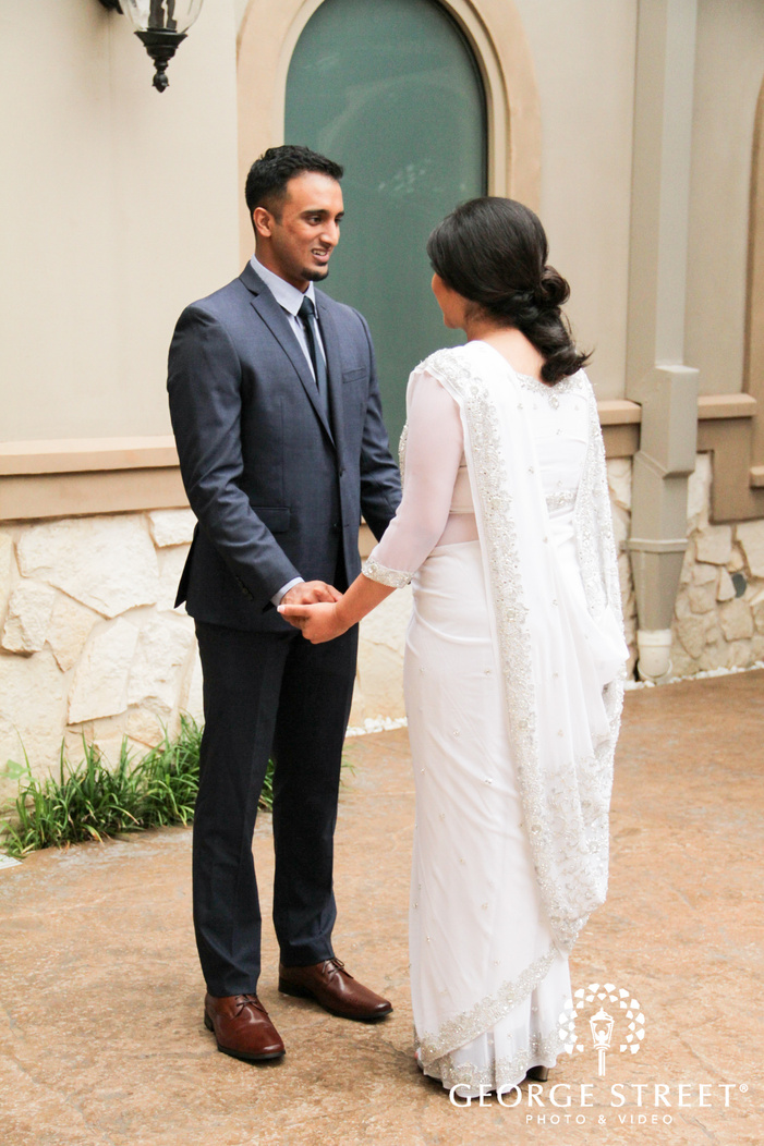bride and groom first look photos