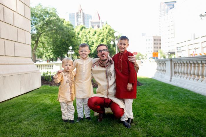 groom portrait with children