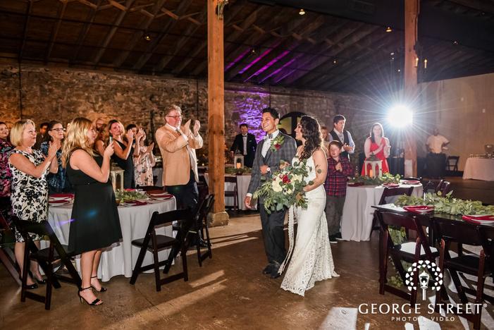 cheery bride and groom reception entrance wedding photography