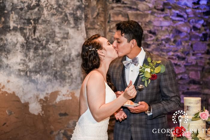 romantic bride and groom cake cutting ceremony wedding photo