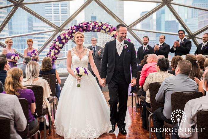 cheery bride and groom ceremony exit at millenium hotel in minneapolis
