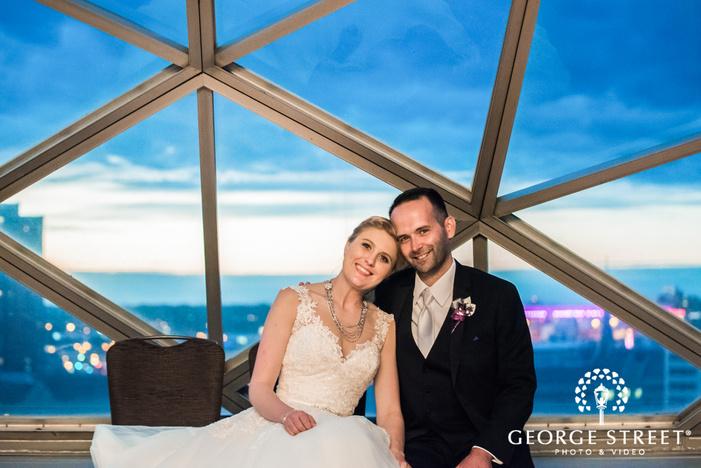 cute bride and groom near window wedding photo
