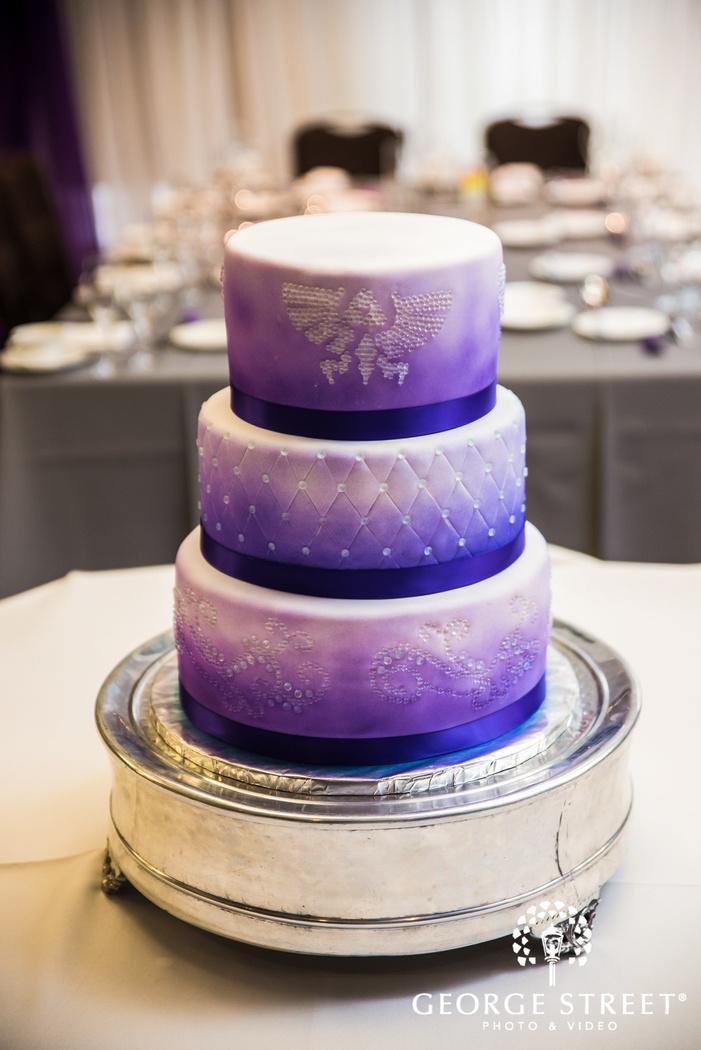 delightful three tier wedding cake wedding photography