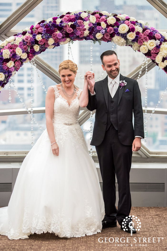 excited bride and groom ceremony exit wedding photo