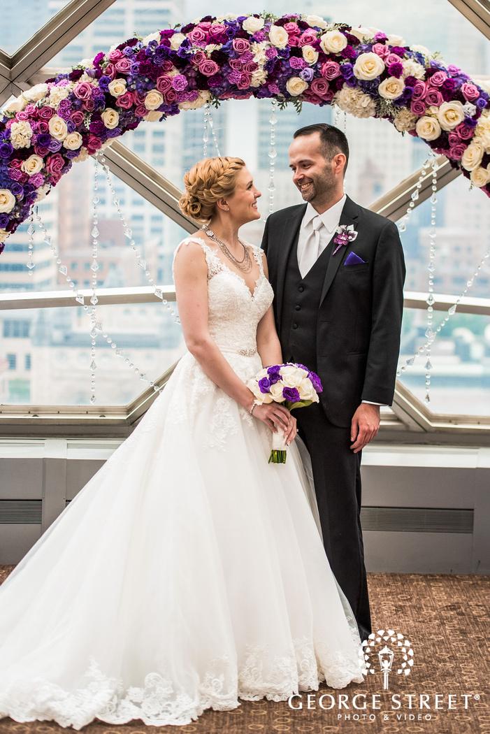 gorgeous bride and groom near altar wedding photos