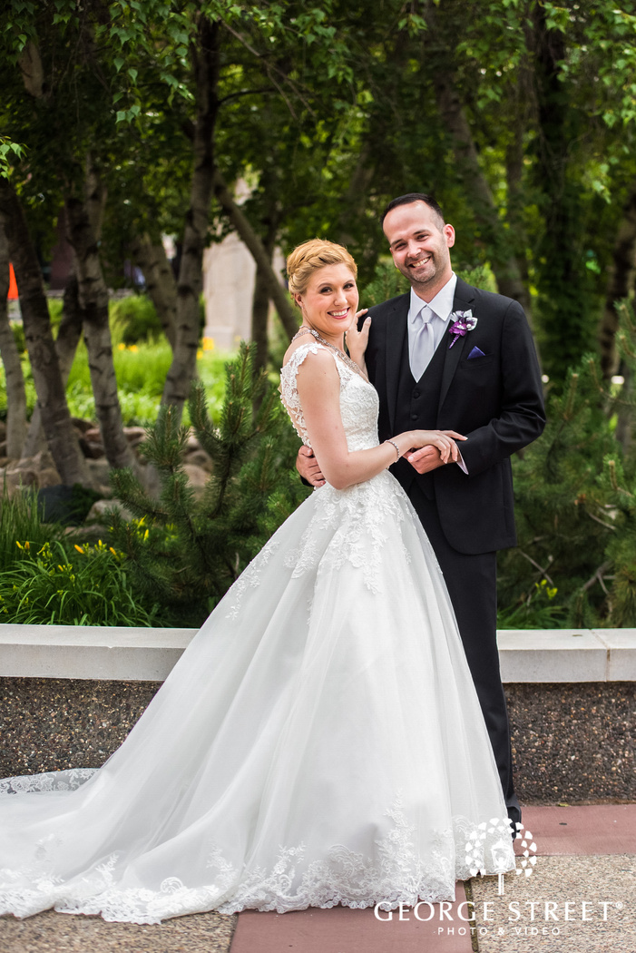 happy briode and groom in walkway wedding photos