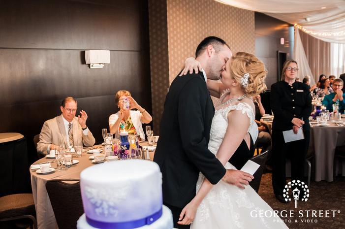 loveable couple near reception table wedding photography