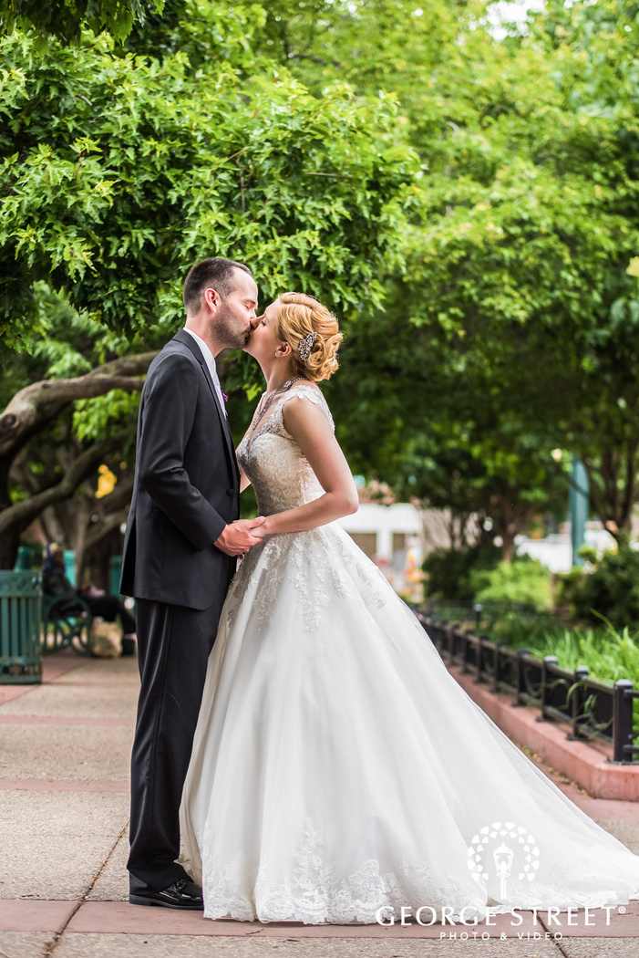 romantic bride and groom on walkway wedding photos