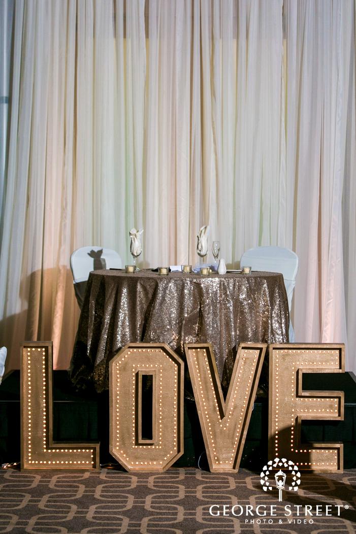 adorable bride and groom reception table wedding photo