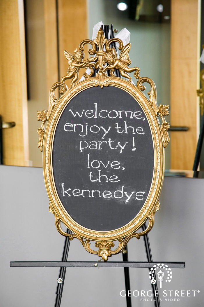 beautiful guest welcome board at reception wedding photo