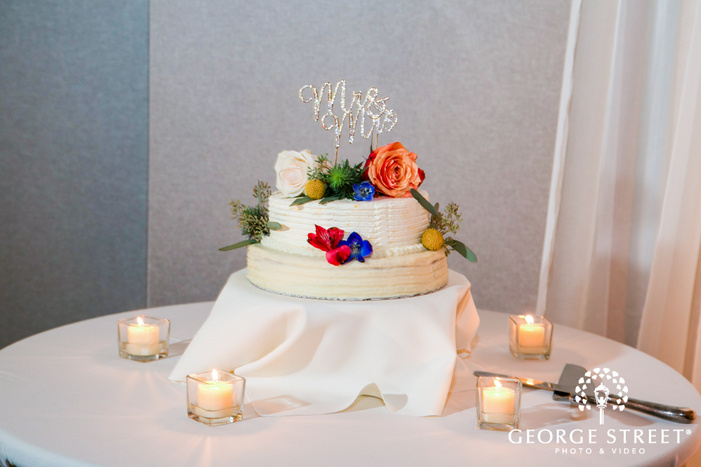 beautiful two tier wedding cake with topper wedding photo