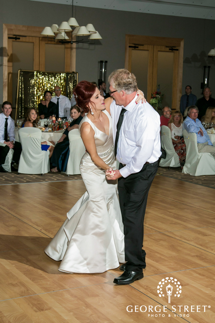 blissful bride and father dance at reception wedding photo