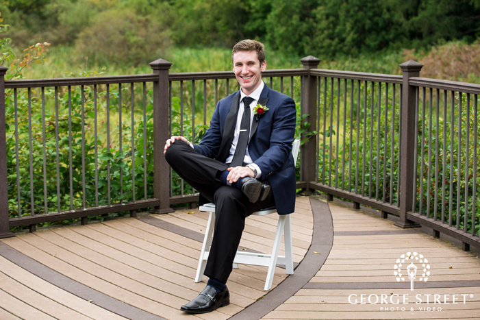 blissful groom with the fence in minneapolis wedding photo