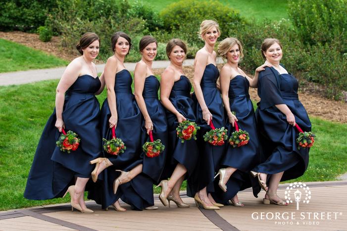 cheerful bridesmaids on walkway at hazeltine national golf club