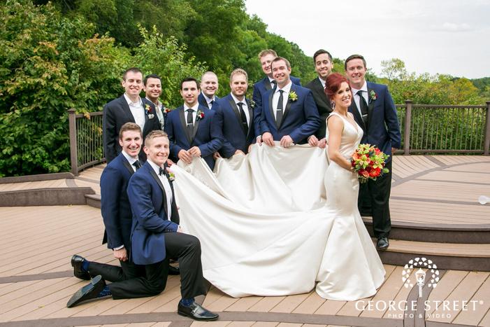 cheerful groomsmen on balcony wedding photography