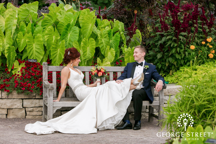 lovely bride and groom on bench wedding photo