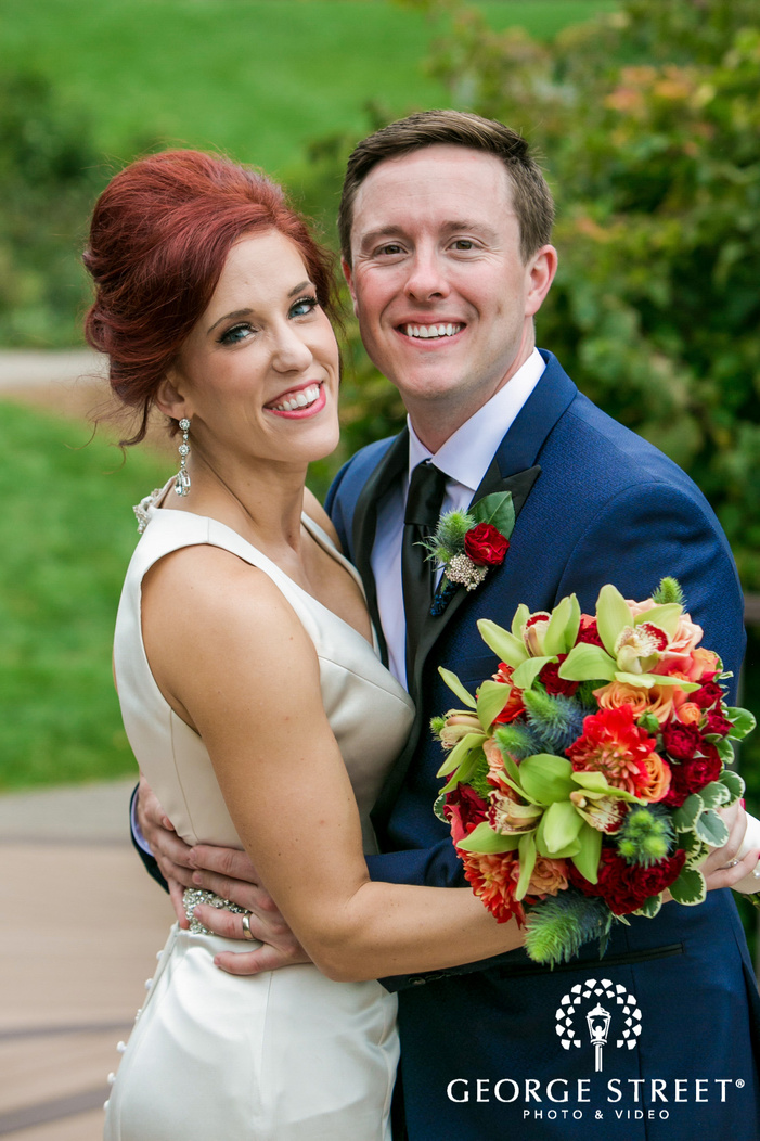 loving bride and groom on walkway at hazeltine national golf club in minneapolis