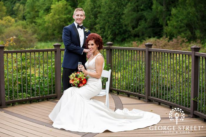 romantic bride and groom on balcony wedding photos