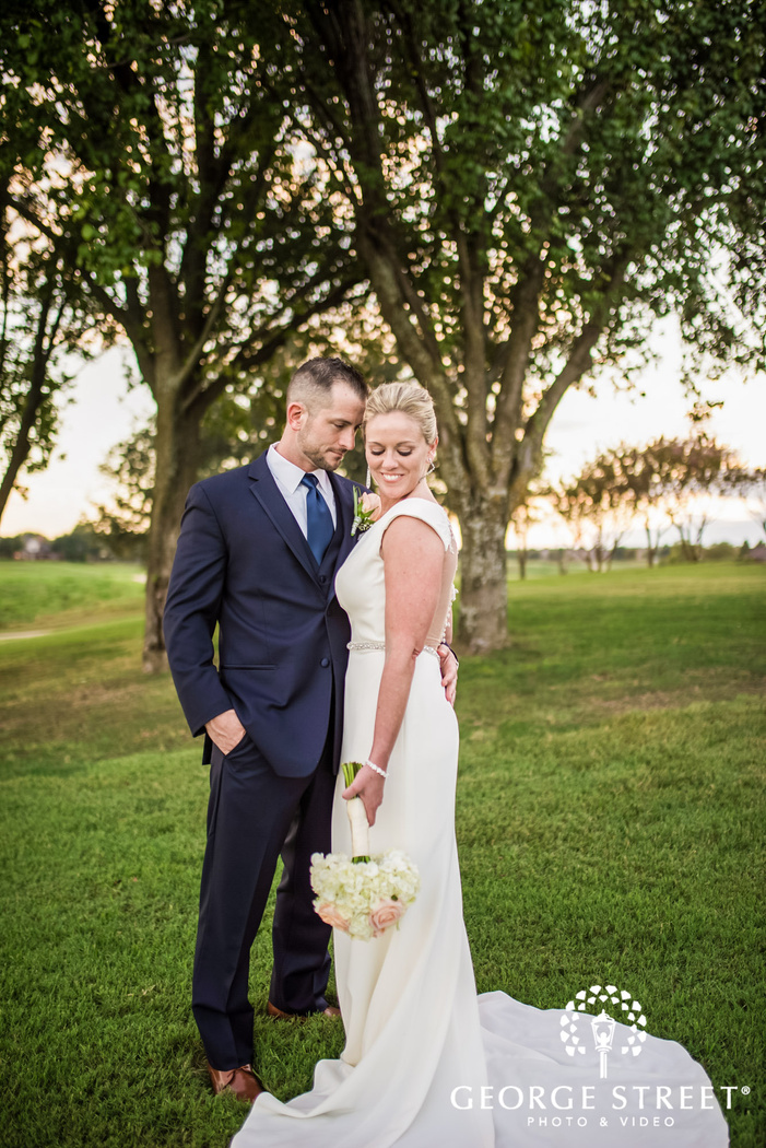 adorable bride and groom in garden wedding photo