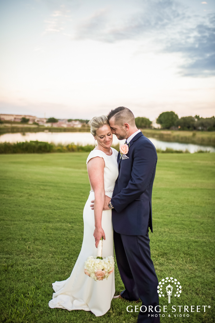 blissful bride and groom in garden in dallas fort worth wedding photography
