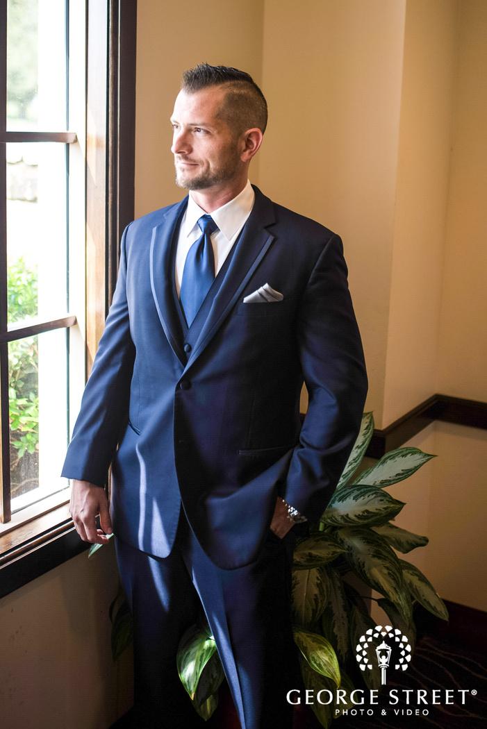 charming groom near window wedding photo