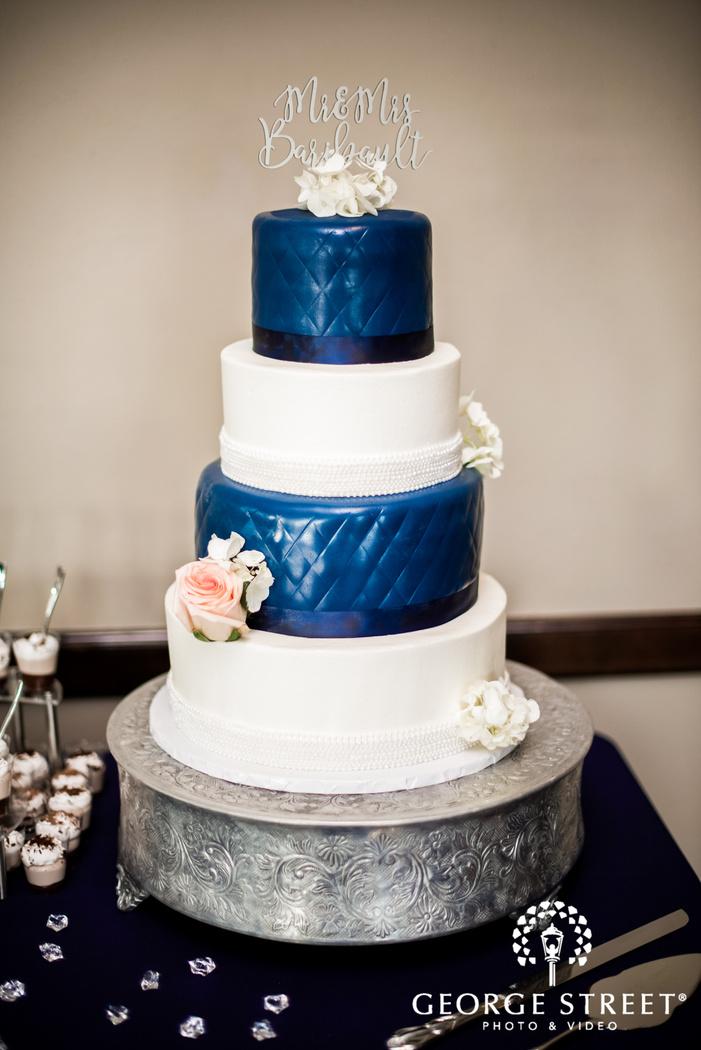 elegant four tier cake with topper wedding photo