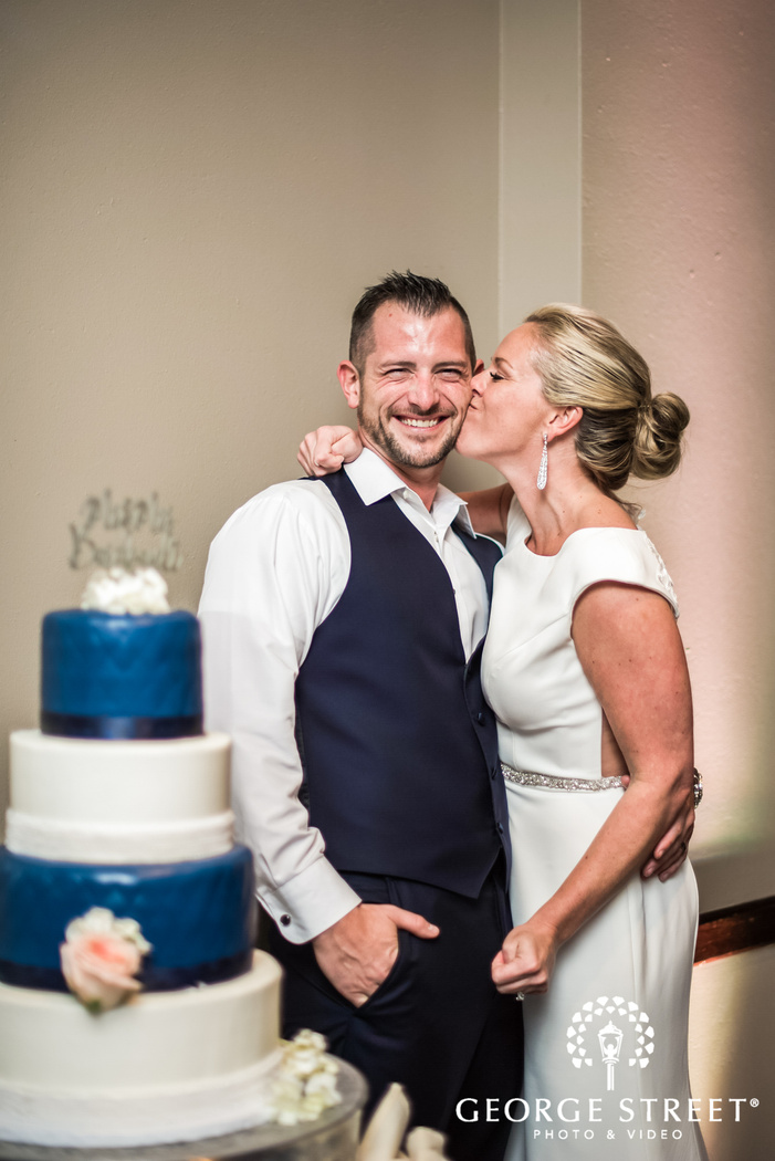 happy bride and groom cake cutting ceremony wedding photos