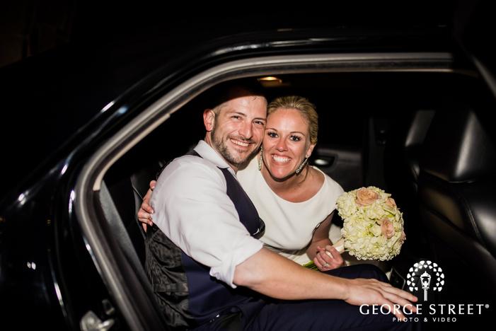 happy bride and groom in car wedding photo