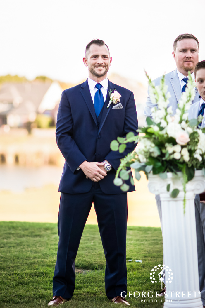 happy groom first look wedding photo