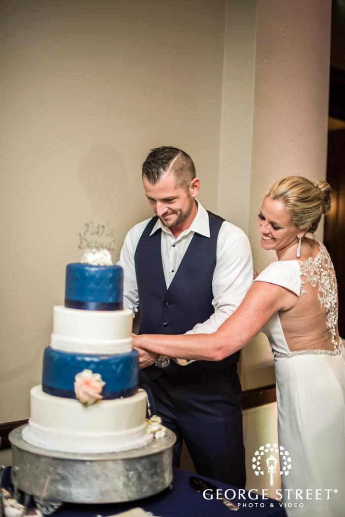 loving bride and groom cake cutting ceremony wedding photo