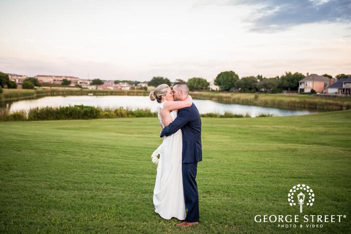 loving bride and groom near lake wedding photo