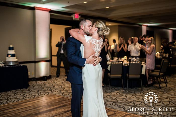 loving bride and groom on dance floor wedding photo