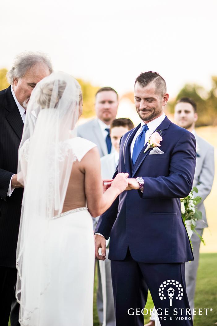 loving bride and groom ring exchange ceremony wedding photography